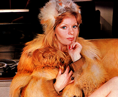 Mary Millington in a fur coat